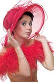Coquette in red hat. Portrait of a beautiful young woman wearing a red hat and feathered red boa over naked shoulders Stock Photos
