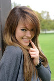 The coquettish beautiful girl. Portrait of coquettish beautiful girl in park - outdoors shot stock images