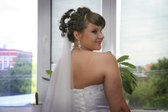 Coquettish bride waiting for her prince Royalty Free Stock Photography