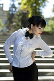 The coquettish brunette in a white blouse Royalty Free Stock Photo