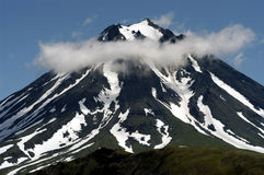 Coquettish cloud. Volcanos and mountains of Kamchatka, Russia Royalty Free Stock Photography