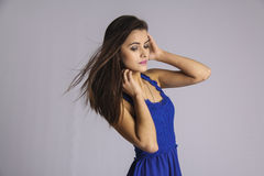 Coquettish girl  with blowing hair Stock Image