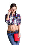Coquettish girl with book Stock Photography
