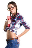 Coquettish girl with book. Smiling coquettish girl in big glasses, casual clothes and naked belly holding book and standing in profile isolated on white royalty free stock photos
