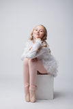 Coquettish little ballerina posing at camera Stock Images