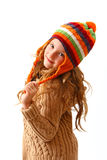 Coquettish little girl in cozy clothes isolated on white. Portrait of coquettish little girl in cozy colorful clothes royalty free stock photography