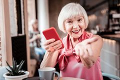 Coquettish short-haired woman pulling her empty palm royalty free stock images