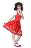 Coquettish woman in the red dress. Coquettish beautiful woman in the red dress and white socks Stock Image