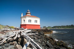 Coquille River Lighthouse with driftwood Stock Image