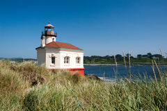 Coquille River Lighthouse with swaying grasses Royalty Free Stock Photos