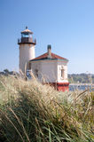 Coquille River Lighthouse with swaying grasses Royalty Free Stock Photo