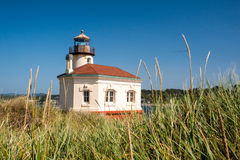 Coquille River Lighthouse with swaying grasses Stock Photos