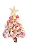 Coquilles de mer formées comme arbre de Noël Photographie stock libre de droits