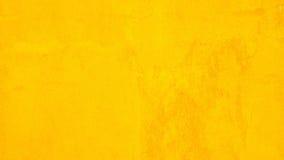 Cor amarela do muro de cimento para o fundo da textura fotos de stock royalty free