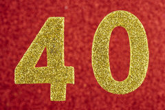 Cor amarela do número quarenta sobre um fundo vermelho anniversary Imagens de Stock