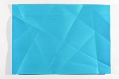 Cor azul papel dobrado imagem de stock royalty free