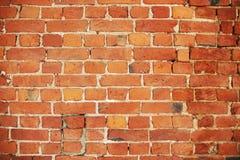 Cor brilhante alaranjada da parede de tijolo para o fundo fotos de stock