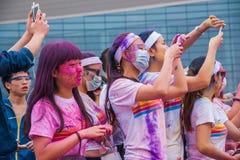 Cor de Chongqing Exhibition Center corrida em jovens Imagem de Stock Royalty Free