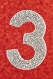 Cor de prata do número três sobre um fundo vermelho anniversary VE Imagem de Stock Royalty Free