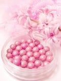 A cor-de-rosa cora nos grânulos Imagem de Stock Royalty Free