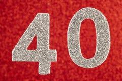 Cor do branco do número quarenta sobre um fundo vermelho anniversary Fotografia de Stock
