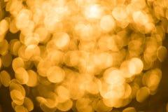 A cor do fundo do ouro do borrão é brilhante Imagens de Stock