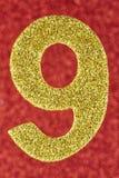 Cor do ouro do número nove sobre um fundo vermelho anniversary ilustração stock