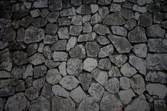 Cor escura da textura da parede de pedra Fotos de Stock