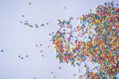 A cor pastel colorido polvilha o fundo Doces pequenos coloridos Páscoa, fundo, textura para easter, espaço da cópia Bonito Foto de Stock Royalty Free