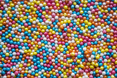 A cor pastel colorido polvilha o fundo Doces pequenos coloridos Páscoa, fundo, textura para easter, espaço da cópia Bonito Fotografia de Stock