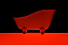 Cor vermelha do banho no fundo preto Fotos de Stock