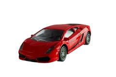 Cor vermelha do brinquedo do carro no fundo branco Imagens de Stock Royalty Free