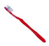 Cor vermelha do Toothbrush no fundo branco. fotos de stock royalty free