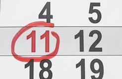 Cor vermelha Marca no calendário em 11 Imagem de Stock Royalty Free