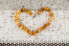 Coração ambarino Imagens de Stock