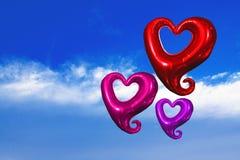 Coração bonito da forma do balão no céu azul Fotos de Stock Royalty Free