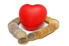 Coração cercado por euro- moedas Imagens de Stock