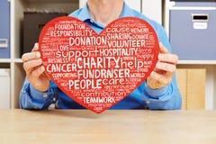 Coração com caridade e nuvem da etiqueta do fundraiser imagem de stock