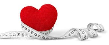 Coração com fita de medição imagens de stock royalty free