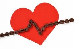 Coração com a linha do cardiograma feita de feijões de café Imagens de Stock
