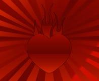 Coração com motivo da flama sobre um fundo do sunburst Fotografia de Stock Royalty Free