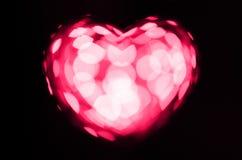 Coração cor-de-rosa do bokeh no fundo preto Foto de Stock Royalty Free