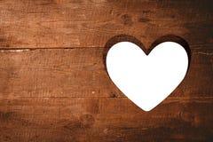 Coração cortado na madeira Fotos de Stock Royalty Free