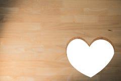 Coração cortado na madeira Foto de Stock Royalty Free