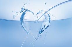 Coração da água na onda Fotos de Stock Royalty Free