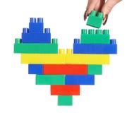 Coração da cor do edifício da mão fotos de stock