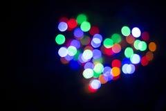 Coração da luz lâmpadas Fora de foco Fotografia de Stock