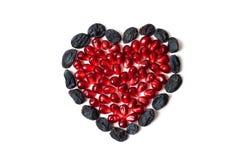 Coração da romã e das passas Foto de Stock Royalty Free