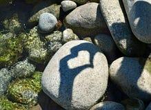 Coração da sombra na pedra Fotografia de Stock Royalty Free