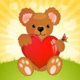 Coração da terra arrendada do urso da peluche Fotos de Stock Royalty Free